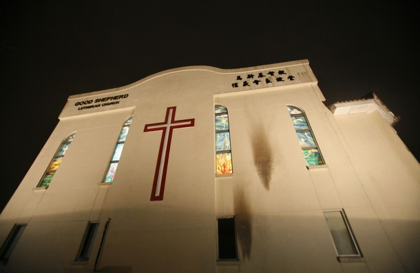 Burn marks are seen on the wall of Good Shepherd Lutheran Church in Petaling Jaya outside Kuala Lumpur