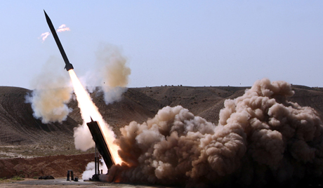 Iran's Revolutionary Guards carry a missile test out