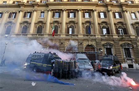 Guardia di Finanza hold shields in front of the Ministry of Finance building during a protest in downtown Rome