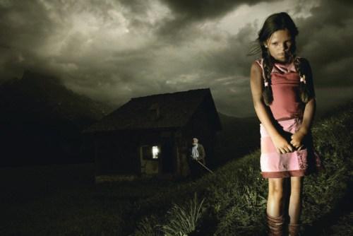 Girl Standing Outside Mountain Shack