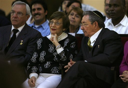 Cuba's President Raul Castro, right, sits next to Adela Dworin, president of Cuba's Jewish community, during a Hanukkah ceremony at the Bet Shalom synagogue in Havana, Cuba, Sunday Dec. 5, 2010. (AP Photo/Ismael Francisco, Prensa Latina)